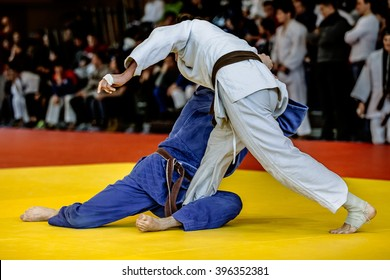 fighters judoists fight in time to compete in judo on a tatami
