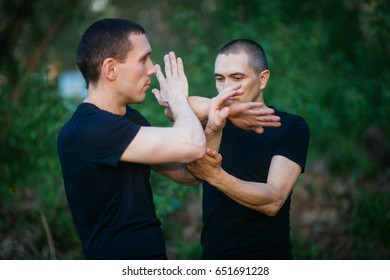 Fighters wing Chun kung fu fighting. Training in martial arts.Chi Sao