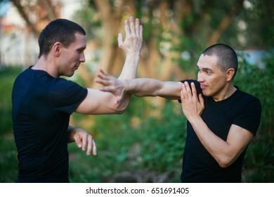 Fighters wing Chun kung fu fighting. Training in martial arts.