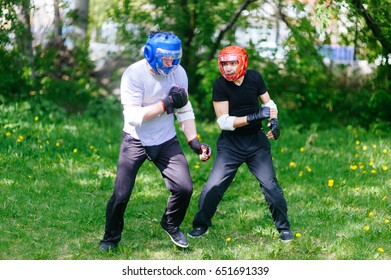 Fighters wing Chun kung-fu fighting. Training in martial arts.