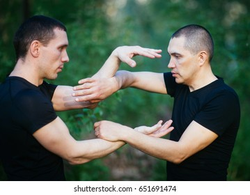 Fighters wing Chun kung-fu fighting. Training in martial arts.Chi Sao