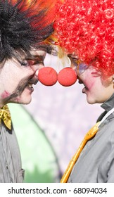 Fighting Clowns Battle It Out Face To Face And Nose To Nose In A Humorous Funny Fight