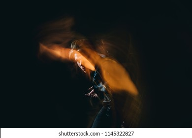fighting dances in the dark. long exposure. soul, thoughts, tension, anxiety and romance, deep psychological emotions