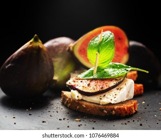 Figs and cheese on bread - tasty appetizers