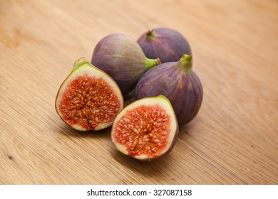 figs on kitchen countertop. One fig is cut in half.