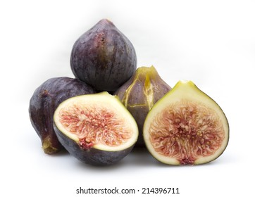 A lot of figs on top of a table