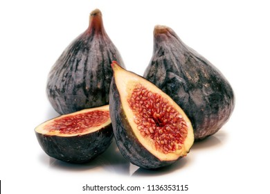 Figs on the white background cut into two halves. Isolated