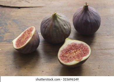 figs on wooden surface