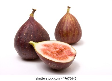 Figs one halved isolated against white background.