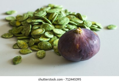 Figs and pumpkin seeds on the table