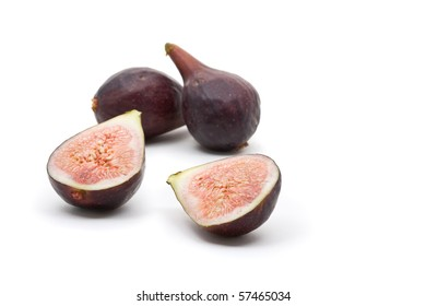 Figs whole and half over white background