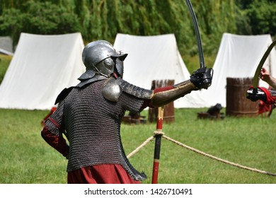 Figth of medieval Polish knights with sabres. Historical reenactment in Brodnowski park in Warsaw, Poland