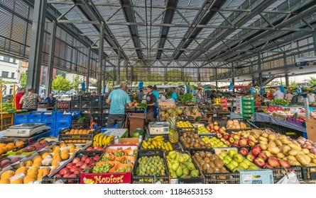 Figueras, Spain - 28 July 2018: Fruits, vegetables for sale at Plaza Del Grano (plaça del Gra) Mercado De La Fruta Y La Verdura Market at Plaça Catalunya. Powered by solar panels in the roof