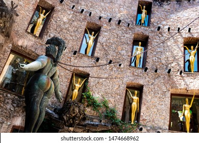 Figueres, Gerona Province/Spain - 07/06/2019: the surrealistic Theatre-Museum of Salvador Dalì, details from main courtyard: a voluptuous woman with chains standing in the stage of the theater.
