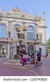 FIGUERES, SPAIN - APRIL 24, 2018: Tourists resting near Salvador Dali museum