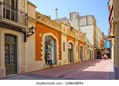 Figueres, Spain - April 24, 2018: Pedestrian area with stores in the center of the city