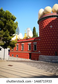 Figueres, Spain. July 25th 2019. Dali Musuem  decorated with eggs and golden statues and Canigo road. The musuem houses the largest collection of artwork by the surrealist Salvador Dali.
