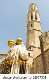 FIGUERES, SPAIN - JUNE 14, 2013: Statue of Dali front he church of Saint Peter in Figueres. Dali Museum was opened on 1974 and houses largest collection of works by Salvador Dali.