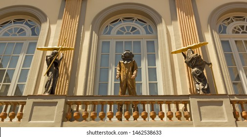 FIGUERES, SPAIN - JUNE 14, 2013: Statue in facade of Dali Museum. It was opened on 1974 and houses largest collection of works by Salvador Dali. It's one of the most visited museums in the world.