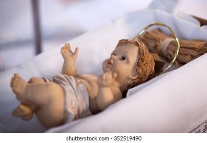 figure of baby jesus in manger - nativity scene