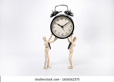 Figure businessmen, trying to hold the clock as possible as they can and bewaring the clock to fall. Concept of time management.