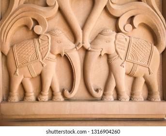 A figure of elephant craved on a sandstone. A beautiful and detailed sculpture with wildlife elements carved on a temple wall in India.