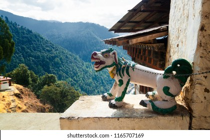 The figure of a fantastic dragon dog on the chain at the entrance to the Chagri Cheri Dorjeden Monastery, Buddhist monastery near capital Thimphu in Bhutan, Himalayas.