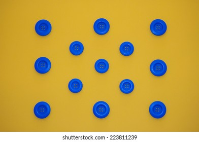 figure formed with blue buttons and yellow background