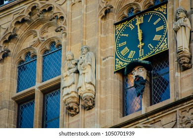 Figure at historic town hall of Cologne, Germany. Figure shows tongue at full hour