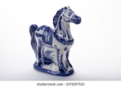 Figure of the horse. National crafts of Russia. Gzhel.