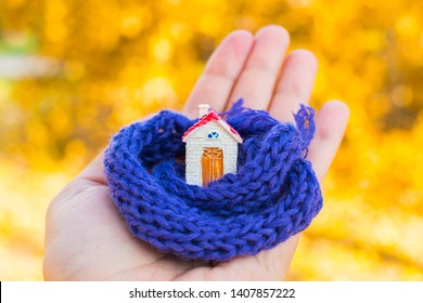 figure of the house wrapped in a scarf on hand. Concept.