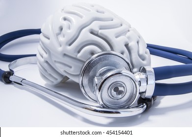 The figure of the human brain with a stethoscope or phonendoscope around him. Picture for medical neurological examinations or surveys