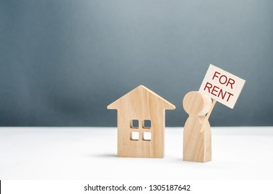 The figure of a man with a poster for rent stands near the house. Search for housing for rent or property rental. The concept of finding a roommate and making money on unused homes. Investments.