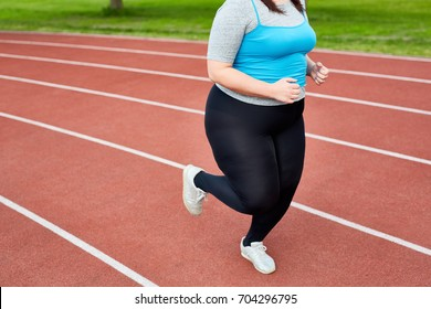 Figure of running fat female in activewear during training