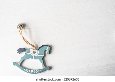 A figure of rustic wooden christmas horses on white background