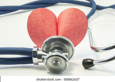 Figure or shape of human heart with stethoscope or phonendoscope around it on white background close up. Concept picture for medical examinations in cardiology or surveys of heart or vascular disease