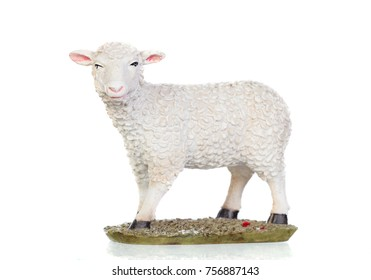 Figure of a sheep for the Nativity isolated on a white background