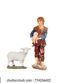 Figure of the shepherd with a sheep for the nativity portal isolated on a white background