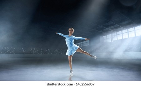 Figure skating girl in professional ice arena.