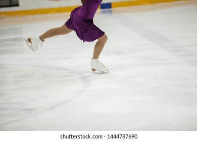 Figure skating, ice skating training. Feet skater on the ice, close-up