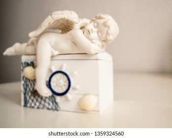 figure of a sleeping angel on the coffer