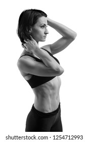 Figure sportswoman on a white background. Trained body. Sport. Monochrom image