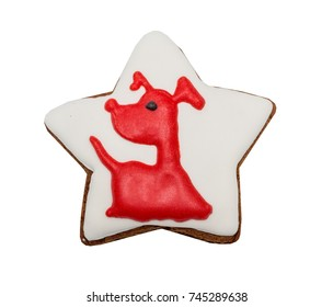 Figure star, gingerbread, covered white and red glaze with dog symbol 2018. Isolated on white background.