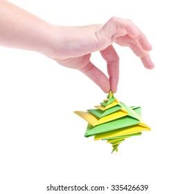 Figure whirligig top of origami in hand