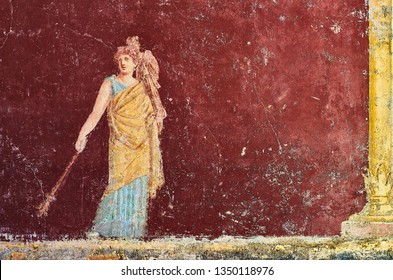 Figure of a woman painted in a Fresco in a Domus of Pompeii, Italy