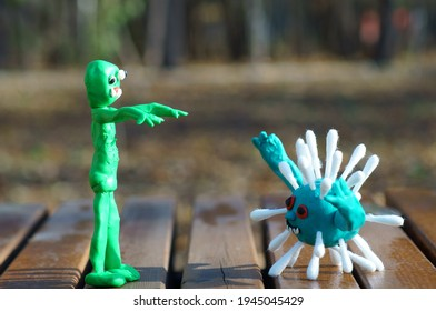 Figure of a zombie and a virus close-up.