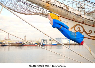 A figurehead of a classic sailing ship, a carved wooden female figure decorating the bow.