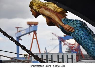 figurehead look into the harbor of Kiel, Germany, with its wharf