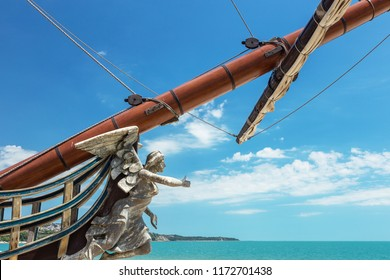 Figurehead (nose shape) is an ornament on nose of sailing vessel, rostrum or caryatid. Wooden sculpture of goddess of victory, Nick, brought happiness and luck to ancient wood sailboat Statue of luck
