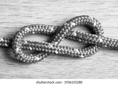 Figure-of-eight knot, sailors world, rolling hitch. Ropes on sail boat board, yacht equipment. Black and white.